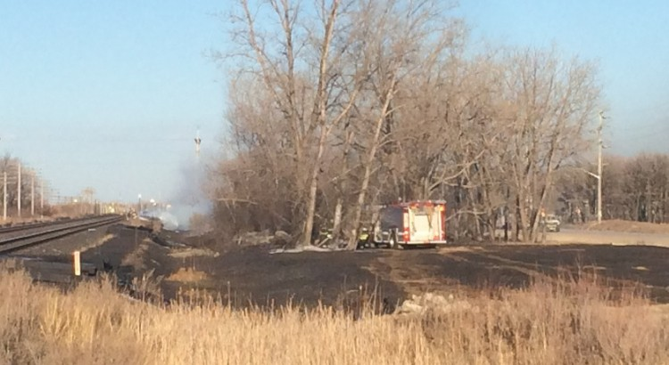 Fire crews were kept busy with a grass fire near the west perimeter Monday evening.