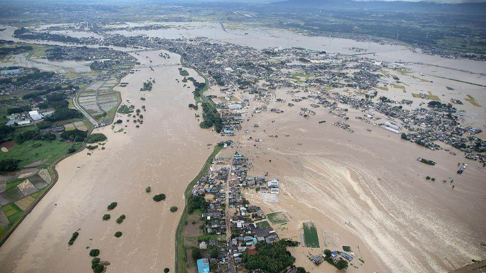 Levees of the Kinugawa River breached in Joso from the heavy rains. (Source: AFP/via TWC)